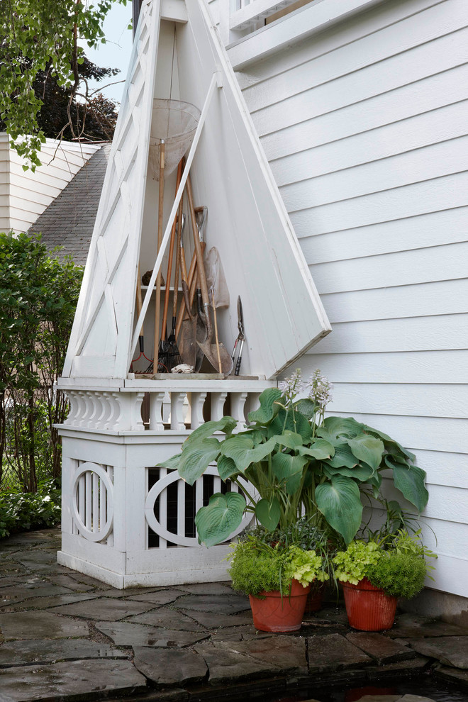 Garden Tool Rack Garage and Shed Traditional with Clapboard Flagstone Lap Siding Lattice Potted Plants Tool Shed Triangle Door White