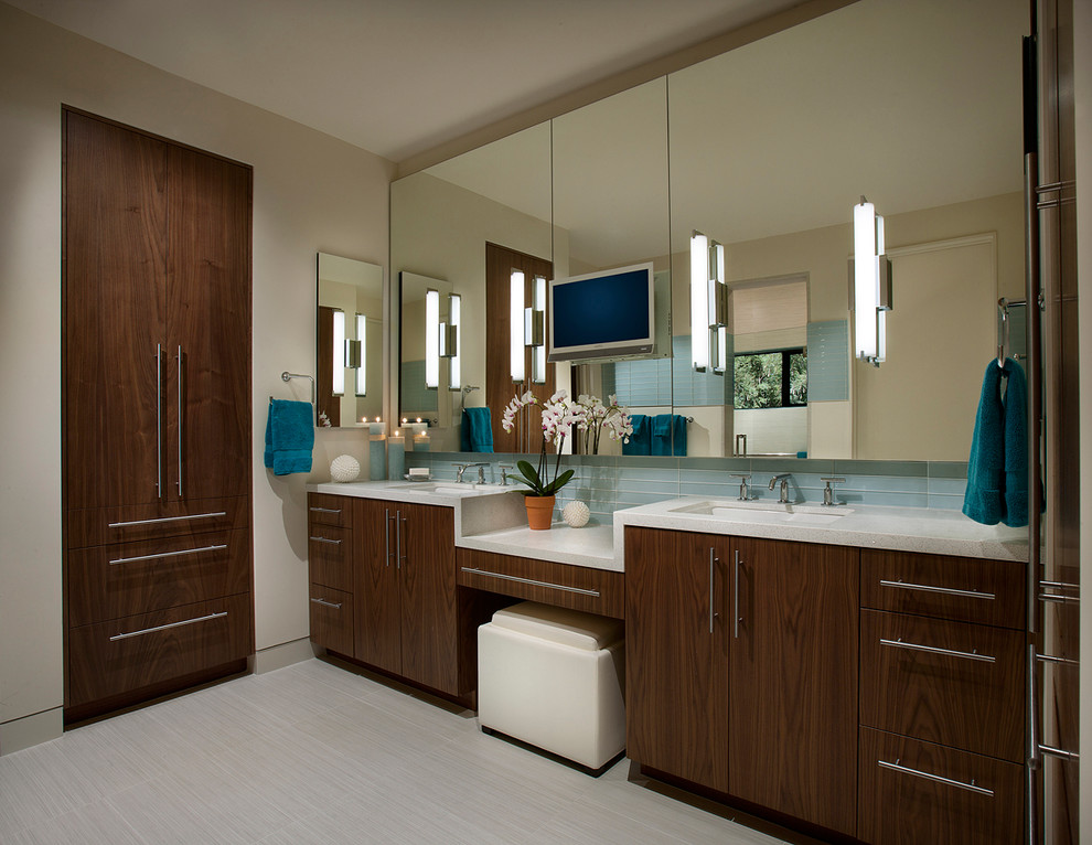 george kovacs Bathroom Southwestern with blue hand towel built in storage cabinet recessed medicine cabinet two sinks