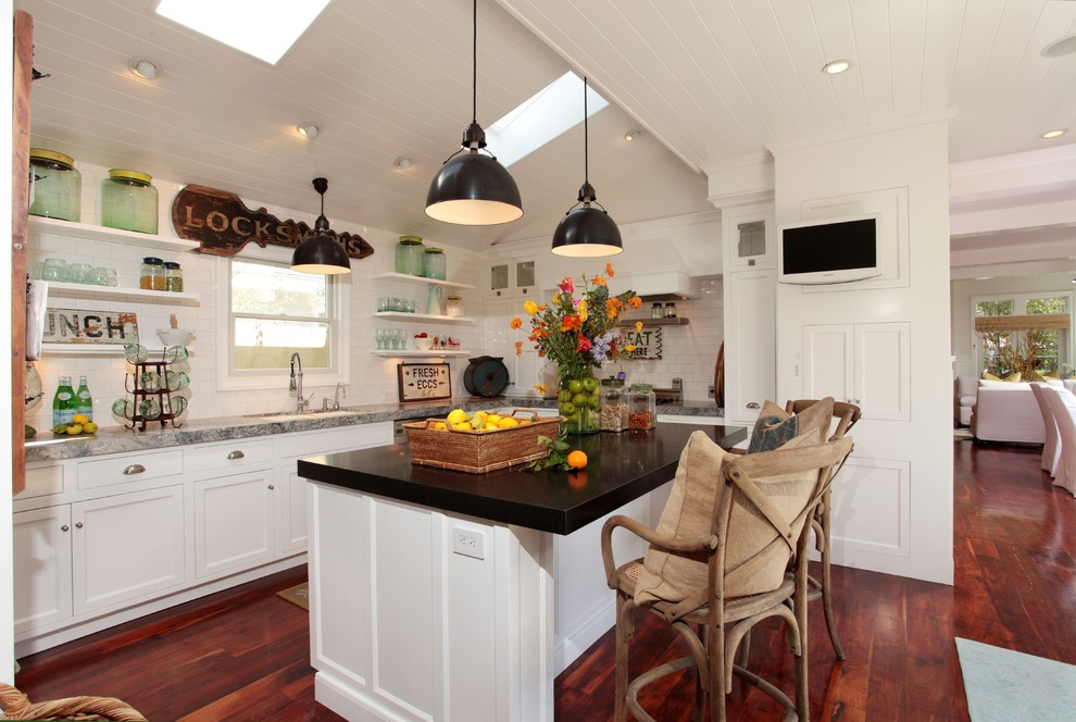 glass canister Kitchen Eclectic with breakfast bar ceiling lighting dark floor eat in kitchen floating shelves floral