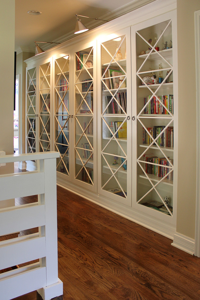 Glass Door Bookcase Family Room Transitional with Accent Lighting Baseboard Beige Walls Book Shelves Crown Molding Glass Front Doors