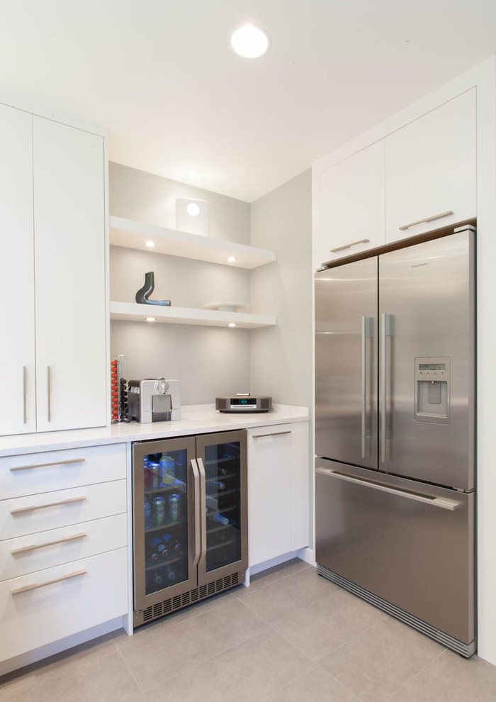 glass door mini fridge Kitchen Contemporary with beverage cooler floating shelves flush cabinets gray tile floor stainless steel appliances