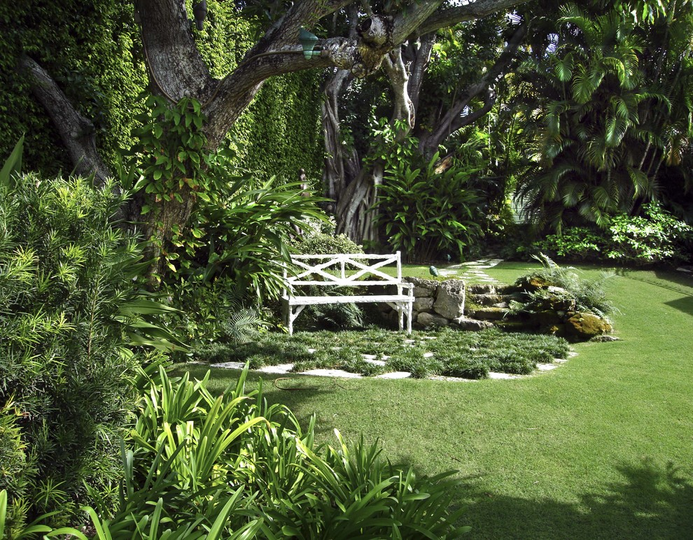 Glider Bench Landscape Tropical with Border Plantings Boulders Grass Hedgerow Lawn Palm Trees Park Bench Path Patio