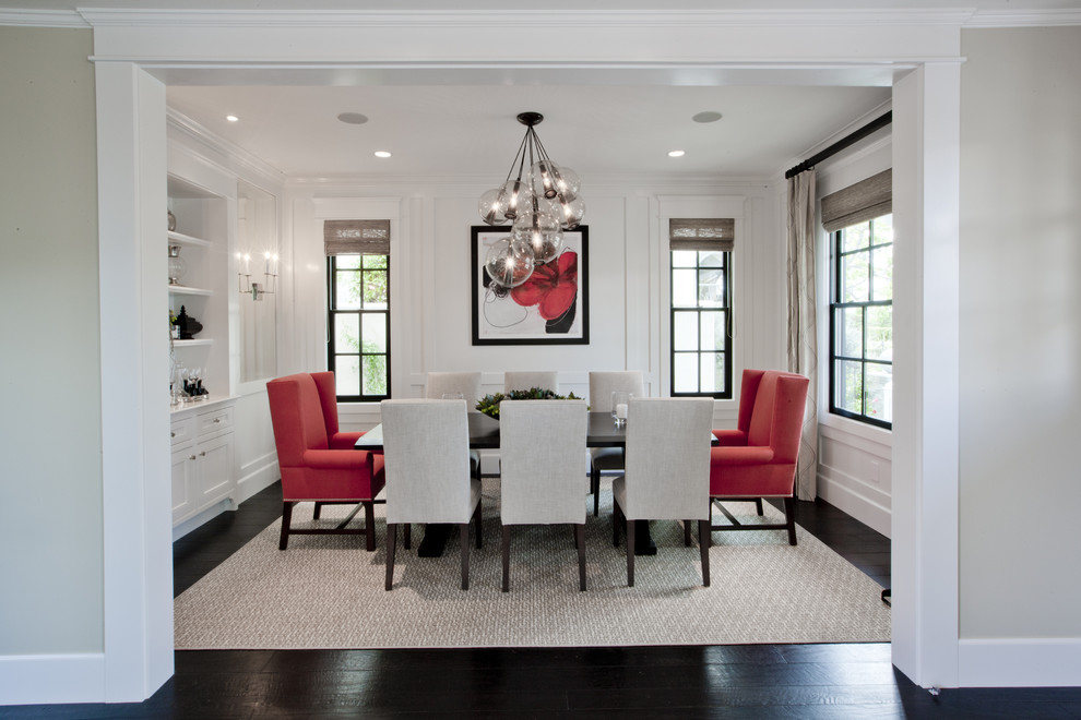 Globe Chandelier Dining Room Transitional with Area Rug Arm Chairs Artwork Baseboards Bubble Chandelier Built in Cabinets Built