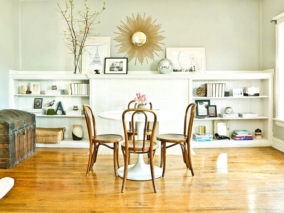 gold sunburst mirror Dining Room Eclectic with artwork baseboard bistro chairs built in bookcase cafe chairs display shelves gold
