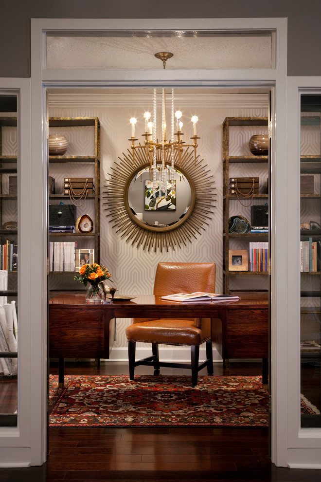 Gold Sunburst Mirror Home Office Eclectic with Accessories Beige Molding Beige Patterned Wallpaper Bold Bookshelf Books Brass and Glass