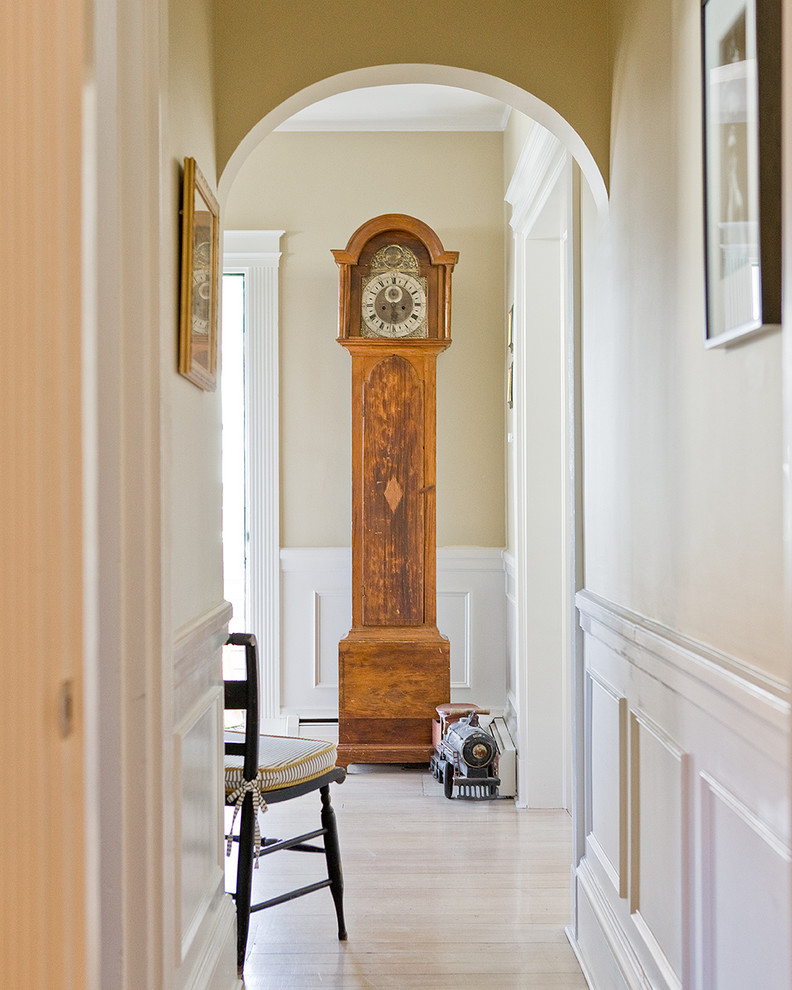 grandfather clocks Hall Traditional with antique toy train arched doorway artwork fluted trim frame and panel woodwork