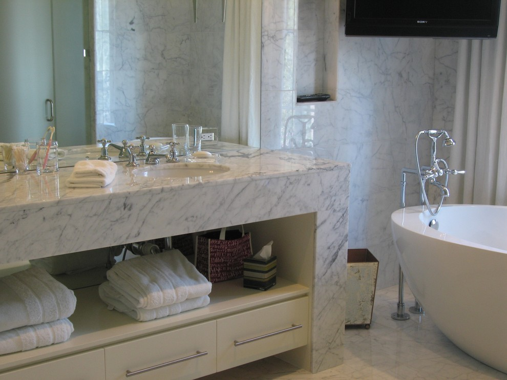 Granite Vanity Tops Bathroom Contemporary with Bathroom Storage Bathtub Freestanding Marble Countertops Marble Wall Neutral Colors Niche Towel
