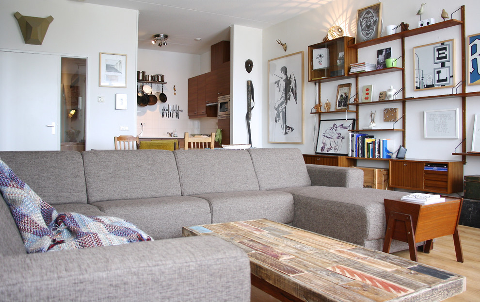 grey sectional sofas Family Room Eclectic with art collection black and white art book shelves Curios gray sectional sofa