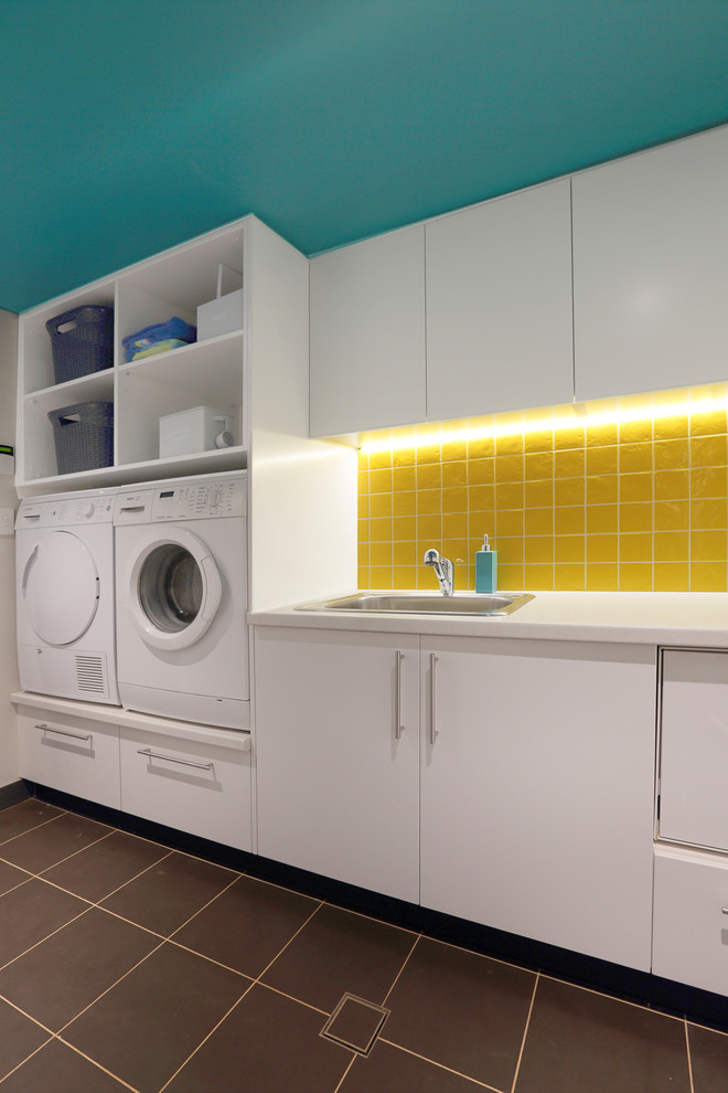 Haier Washing Machine Laundry Room Contemporary with Laundry Storage Sink Tile Floor Under Cabinet Lighting White Appliances Yellow Tile