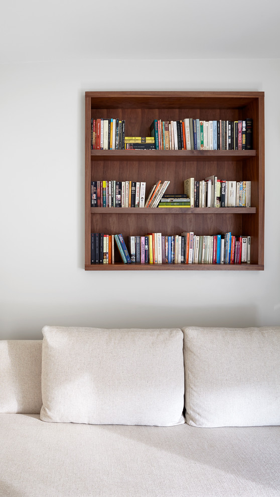 Hanging Bookshelf Family Room Modern with Bookshelf Dark Stained Wood Detail White Couch White Upholstery White Walls
