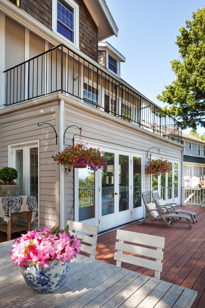 hanging planter Deck Traditional with black railing deck french doors gray siding hanging platers open outdoor dining