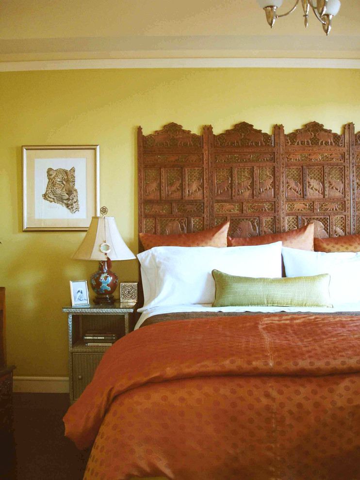 Headboard Queen Bedroom Eclectic with Bedside Table Carved Wood Nightstand Orange Duvet Silk Pillows Table Lamp Wall