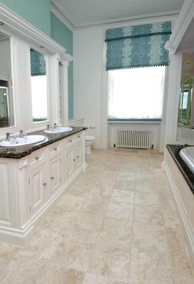 Hexagon Tile Bathroom With Blue Bathroom Cream Floor Tiles Dark Countertops  Dual Sinks Large Bathroom Tiffany