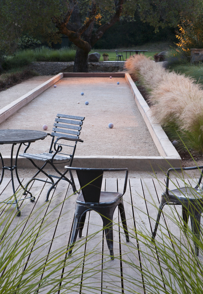 High Ball Glass Landscape Contemporary with Accent Lighting Bistro Table and Chairs Bocce Ball Bocce Court California Deck