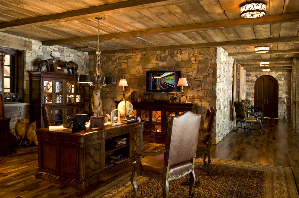 Hooker Furniture Home Office Rustic with Area Rug Ceiling Lighting Sconce Dark Floor Earth Tone Colors Leather Office