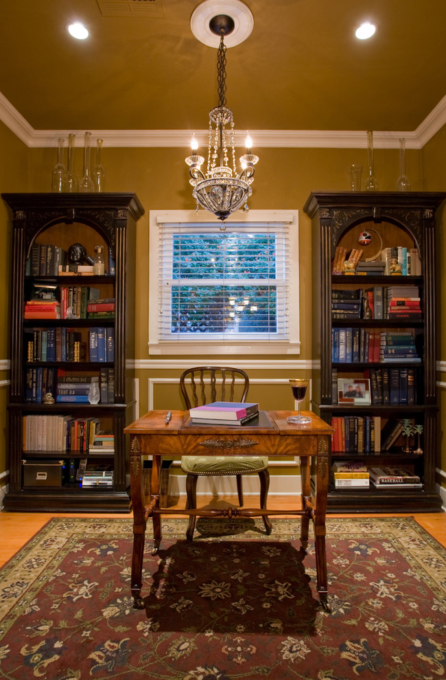 Hooker Office Furniture Home Office Traditional with Antiques Area Rug Bookcase Bookshelves Ceiling Lighting Chandelier Crown Molding Gold Wall