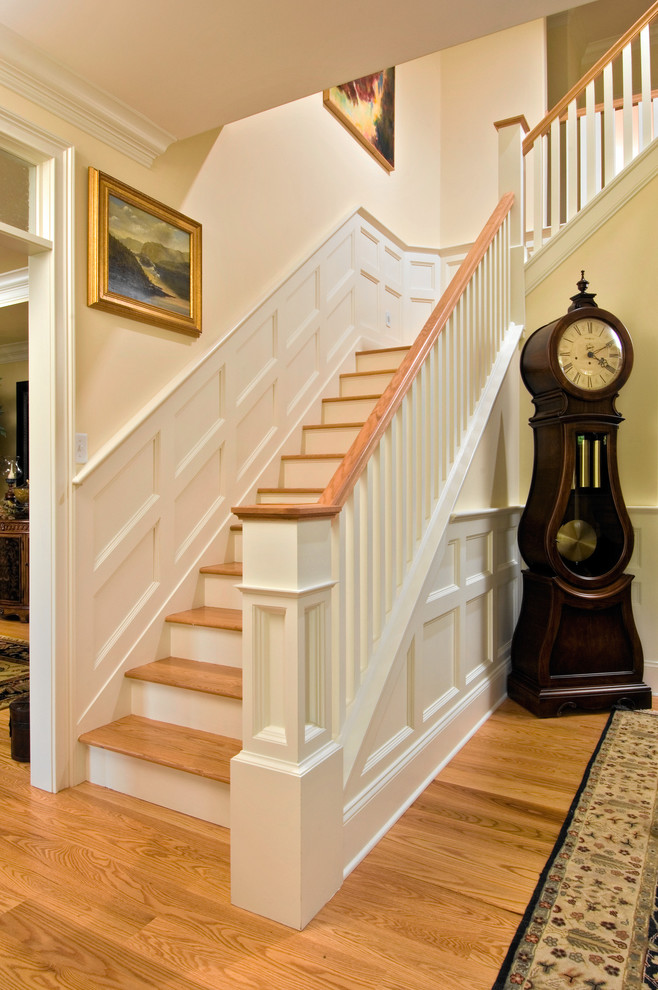 Howard Miller Wall Clock Staircase Traditional with Box Moulding Chair Rail Foyer Grandfather Clock Hardwood Floor Moulding Painting Paneling