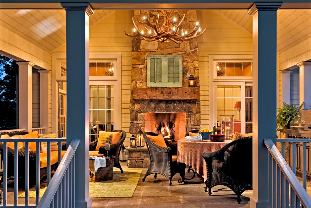 Human Touch Massage Chair Porch Traditional with Antler Chandelier Back Porch Hearth Porch Rustic Seating Area Stone Fireplace Traditional