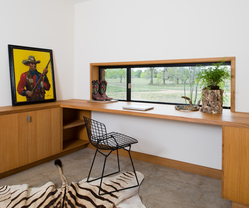 Humanscale Keyboard Tray Home Office Modern with Built in Cabinets and Shelves Built in Desk Cement Floor Corner Framed Art Metal