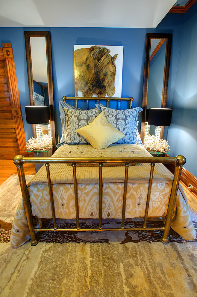 ikat bedding Bedroom Eclectic with area rug baseboards bed pillow bedside table blue walls bold colors bright