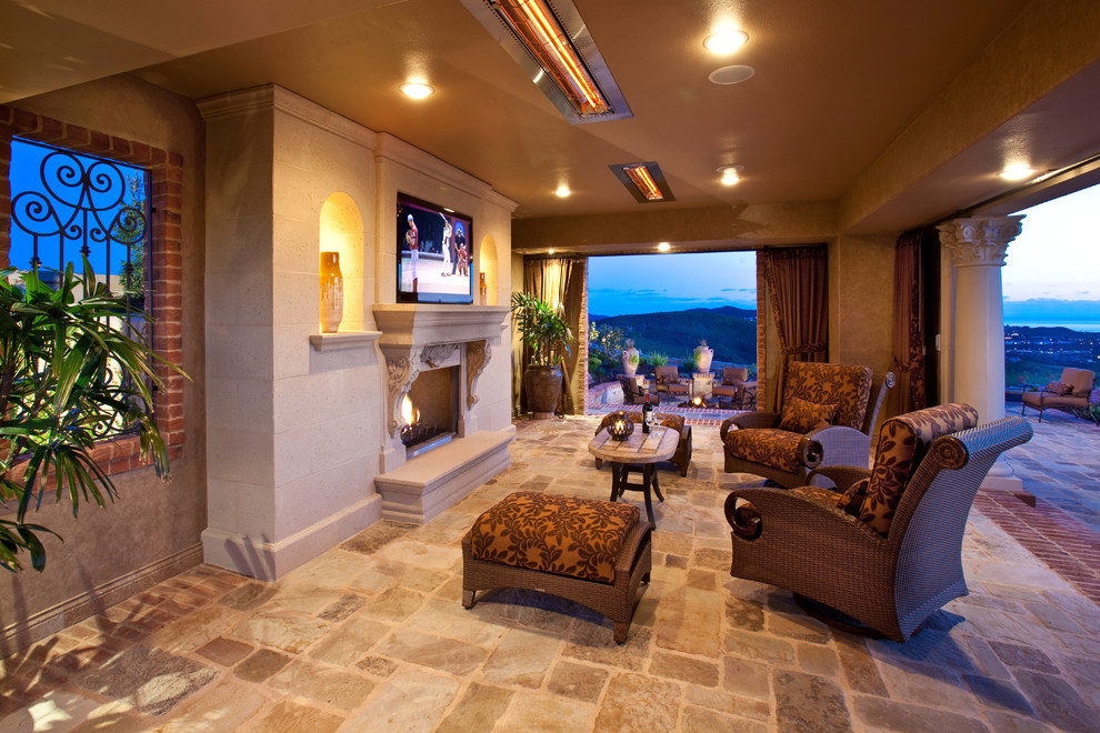 indoor propane heaters Patio Mediterranean with brick trim carved stone columns covered patio curtain panels Fireplace iron scrollwork