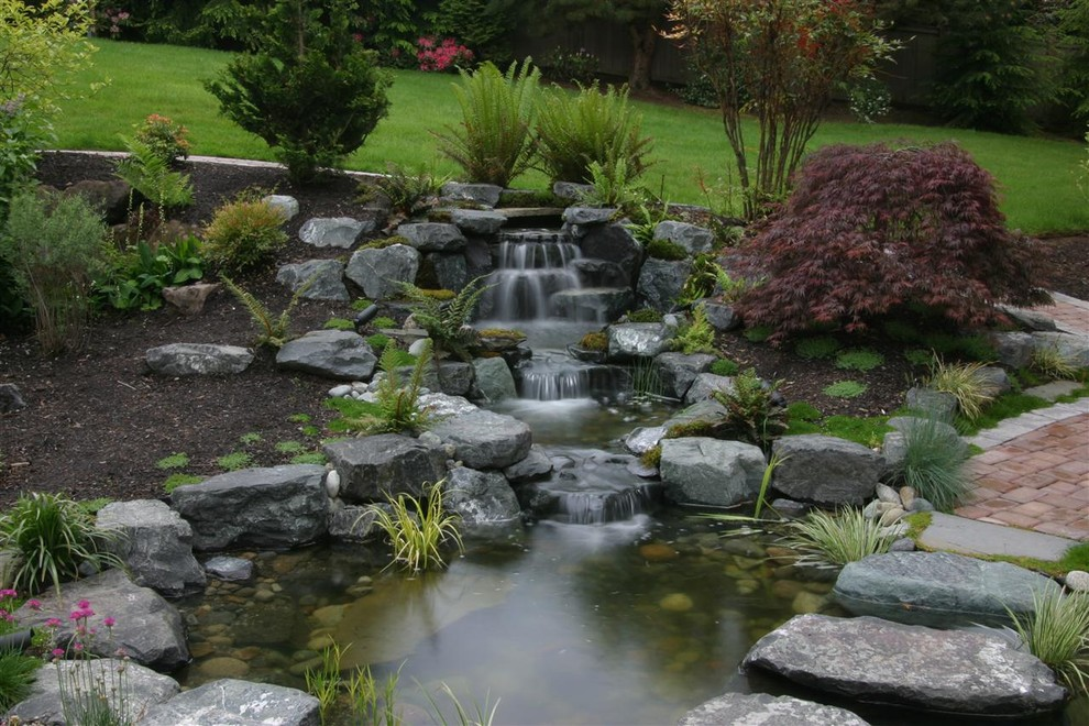 Indoor Water Fountains Landscape Contemporary with Arbor Boulders Bridge Creek Deck Driveway Fences Fire Pit Flowers and Plants