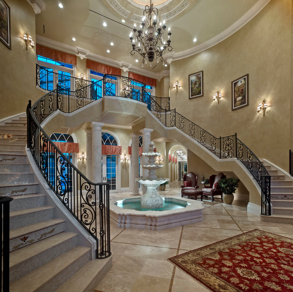indoor water fountains Staircase Mediterranean with arched window beige faux finish wall beige textured wall beige tile floor