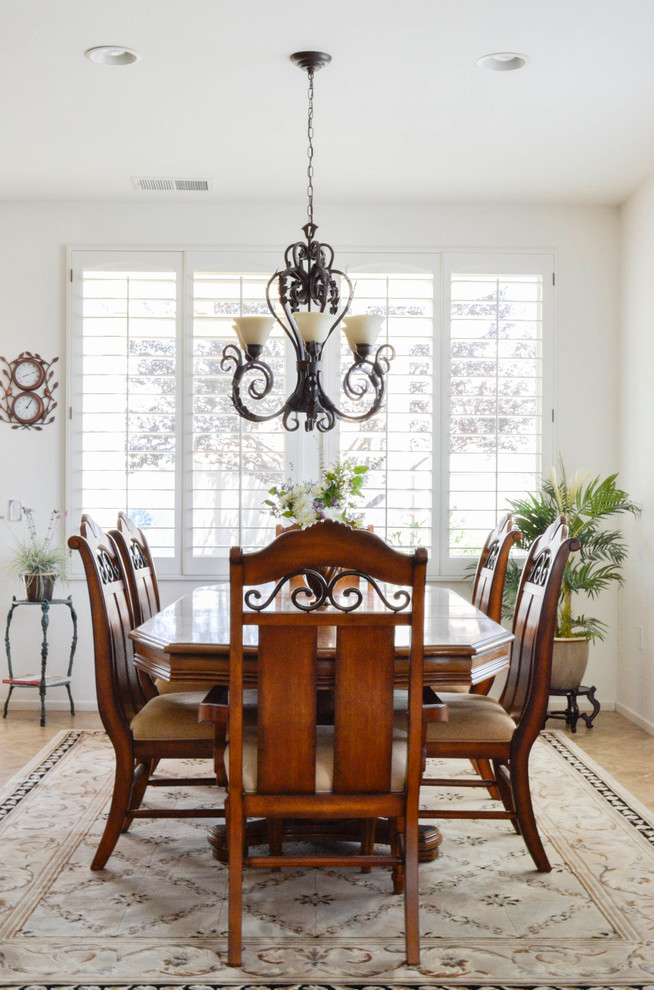 Iron Chandelier Dining Room Mediterranean with Custom Cabinets Heavy Details Medallion Oak One Story Palm Springs Plantation Shutters