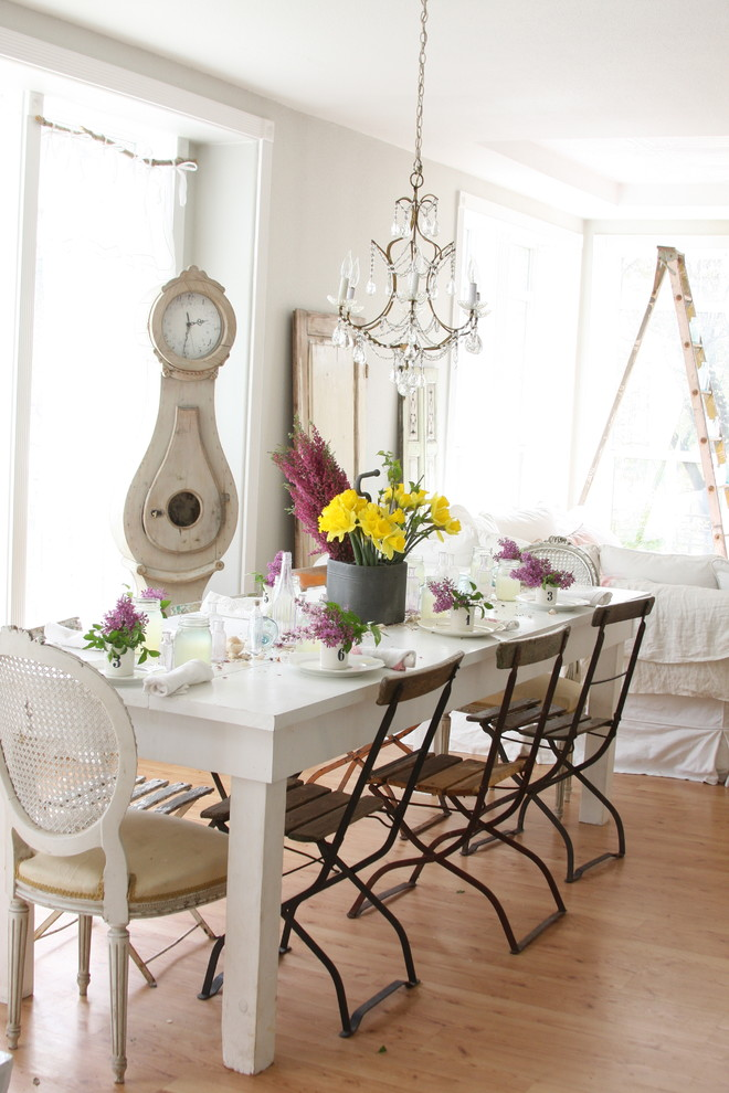 Iron Chandelier Dining Room Shabby Chic with Cane Furniture Centerpiece Chandelier Farmhouse Table Floral Arrangement Folding Cafe Chairs French