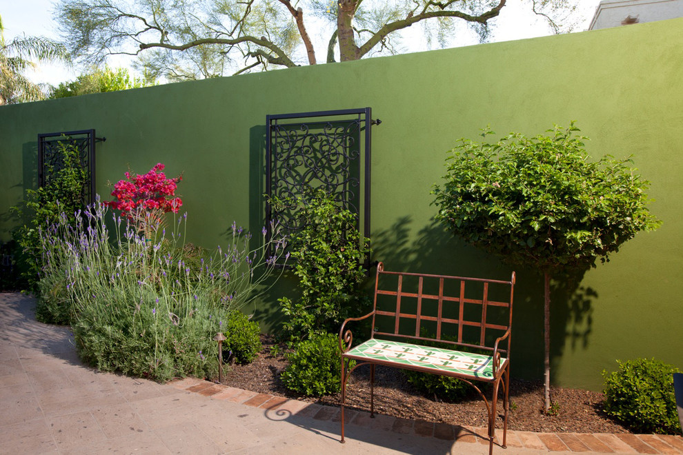 iron trellis Patio Mediterranean with accent wall avocado bark mulch bench brick edging curved flower bed green