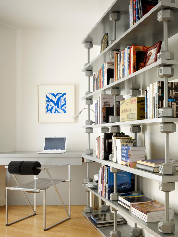 Ja Henckels Home Office Modern with Bookshelves Chair Corner Desk Framed Wall Art Hand Weights Hardwood Floor Library