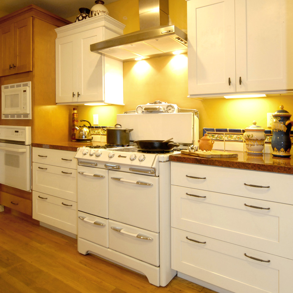 Jeremiah Lighting Kitchen Mediterranean with Contrasting White and Wood Cabinetry Inset Tile and Wood Floor Okeefe And