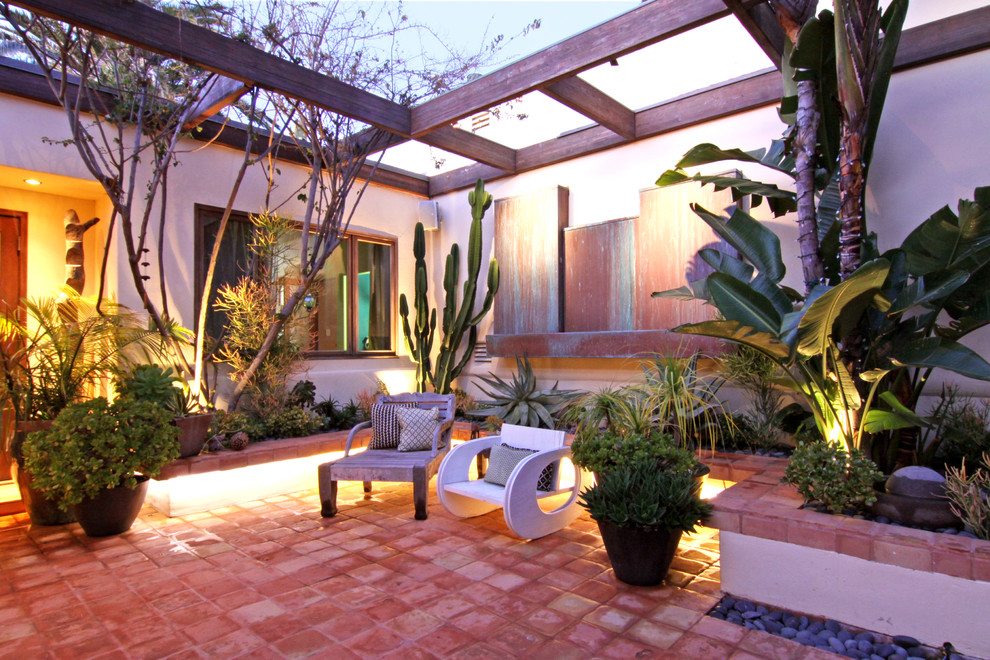 jeremiah lighting Patio Tropical with covered entry landscaping lounge chair outdoor seating pavers pergola plant pots planting