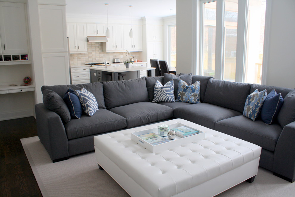 Jessica Mcclintock Furniture Family Room Contemporary with Blue Pillows Dark Gray Sectional Sofa Dark Wood Floor Kitchen Light Gray