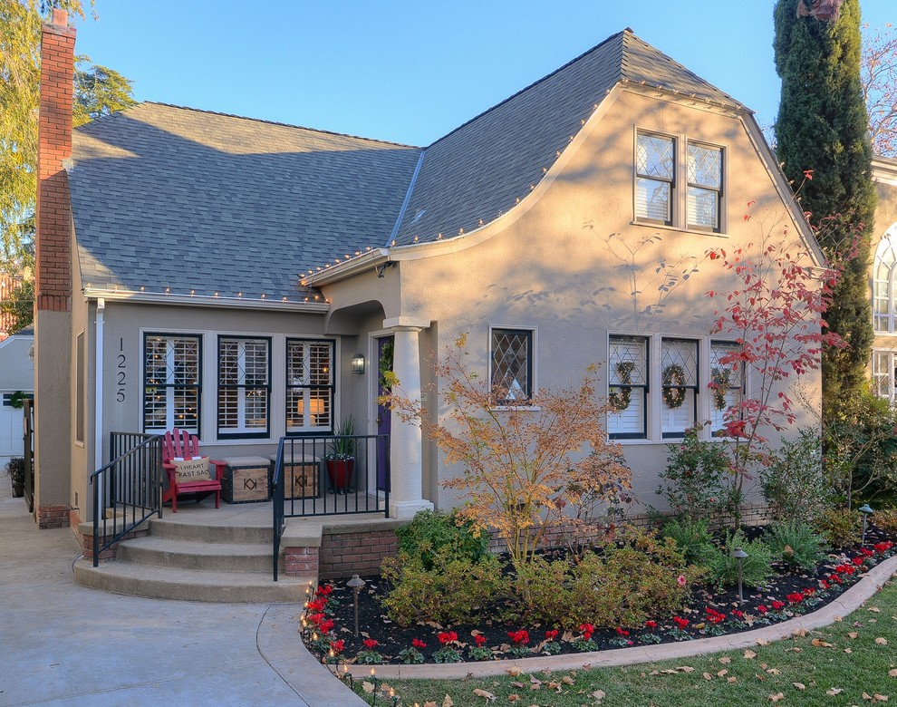 Joy Carpets Exterior Traditional with Adirondack Chair Box Storage Ottomans Brick Chimney Clipped Gable Roof Column Curb