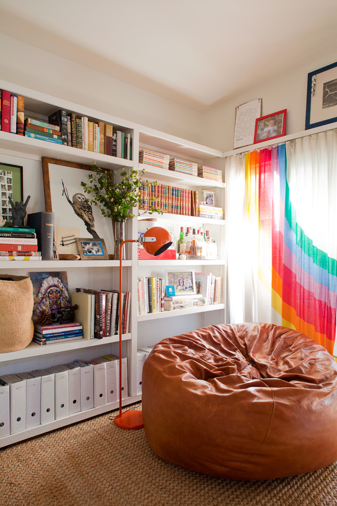 jute rugs Living Room Eclectic with book shelves brown leather bean bag chair orange floor lamp organization owl