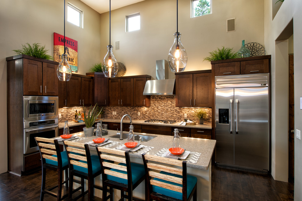 kichler lighting Kitchen Transitional with breakfast bar clerestory windows dark wood floors eat-in kitchen glass pendant light