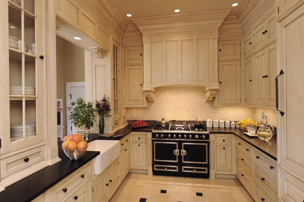 Kitchen Canisters Kitchen Traditional with Apron Sink Cabinet Front Refrigerator Ceiling Lighting Crown Molding Farmhouse Sink Floor