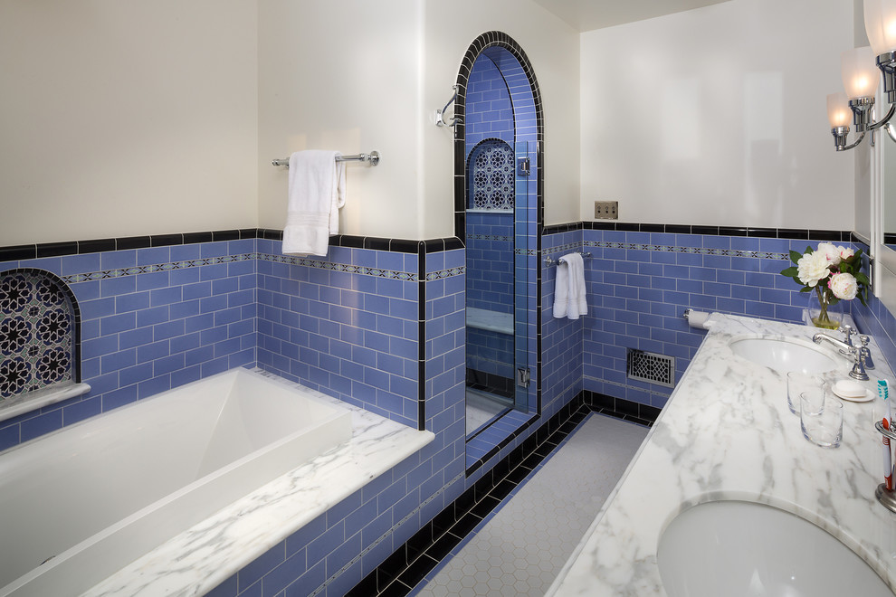 Kohler Bancroft Bathroom Mediterranean with 20s Spanish Arched Shower Door Blue Tile Bullnose Plaster Calacatta Marble Decorative