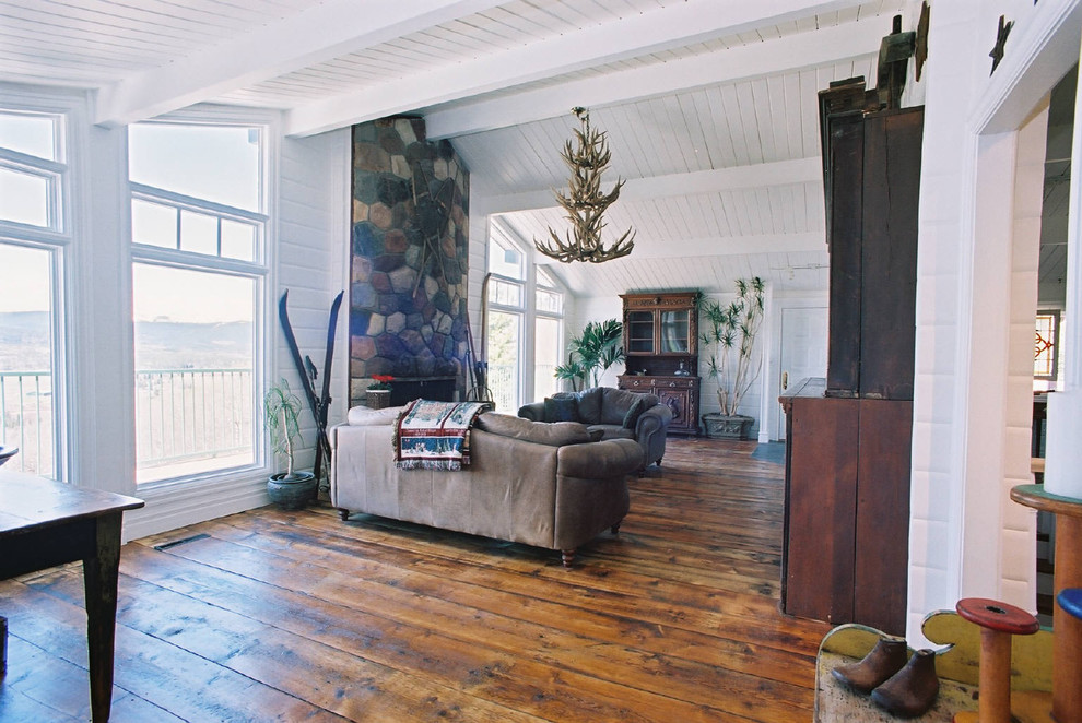 Konecto Flooring Living Room Rustic with Antique Floor Antler Chandelier Exposed Beams House Plants Rustic Stone Fireplace Surround