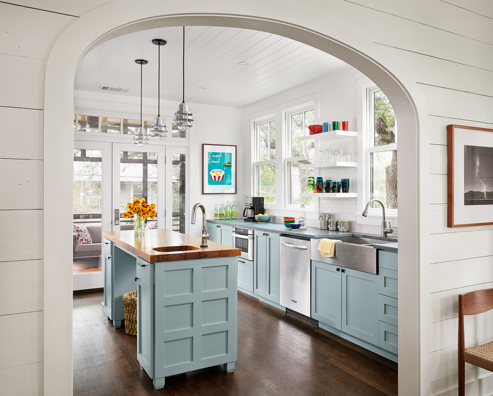Kraus Faucets Kitchen Farmhouse with Arched Doorway Floating Shelves Framed Artwork French Doors Glass Doors Kitchen Island