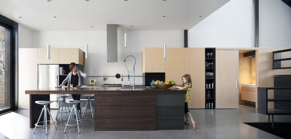 kraus faucets Kitchen Modern with clean lines concrete floor counter stools dark stained wood hood kitchen island