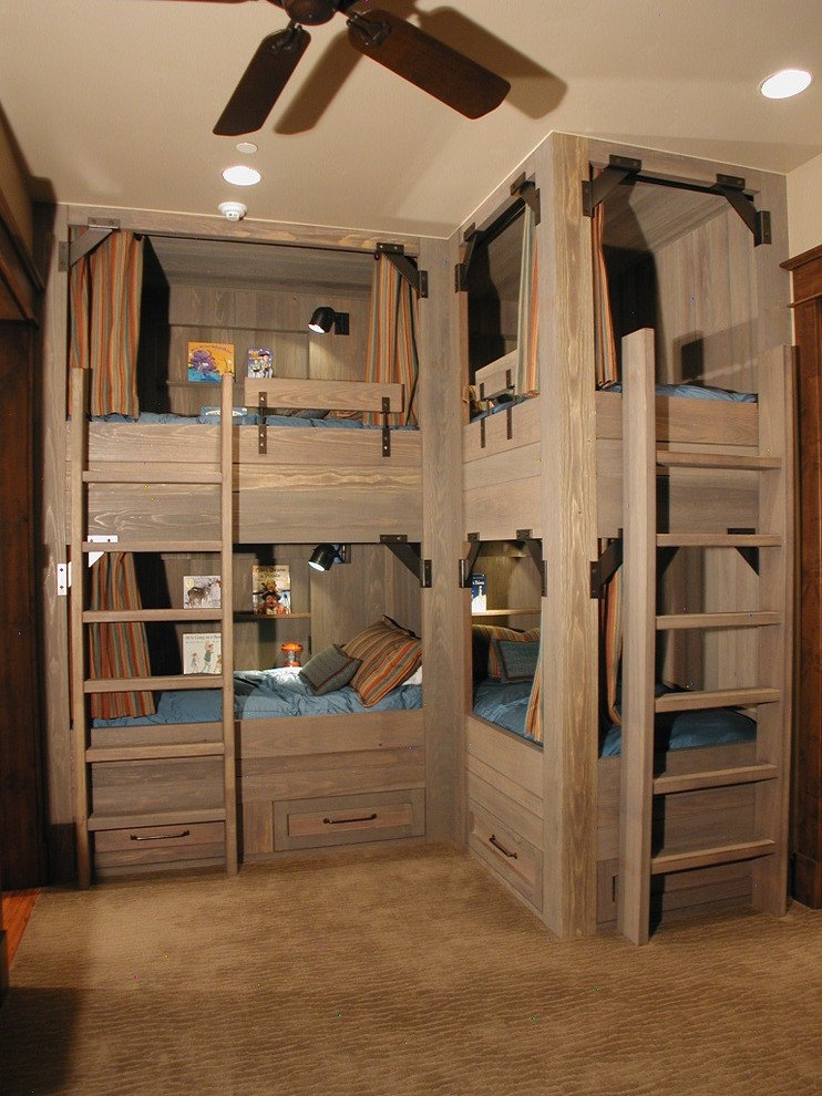 L Shaped Bunk Beds Kids Rustic with Accent Lighting Beige Carpet Beige Wall Blue Bedding Brown Carpet Built in Bunk