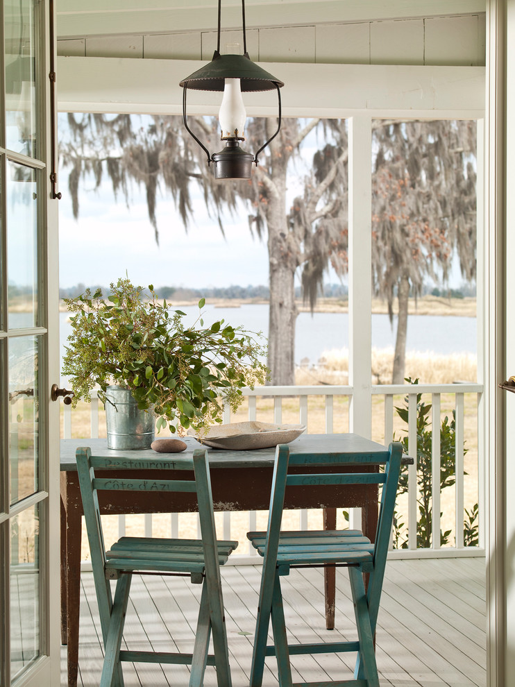 lantern light fixtures Porch Shabby chic with beach house cottage french door lantern reclaimed rustic shabby-chic wood chair wood