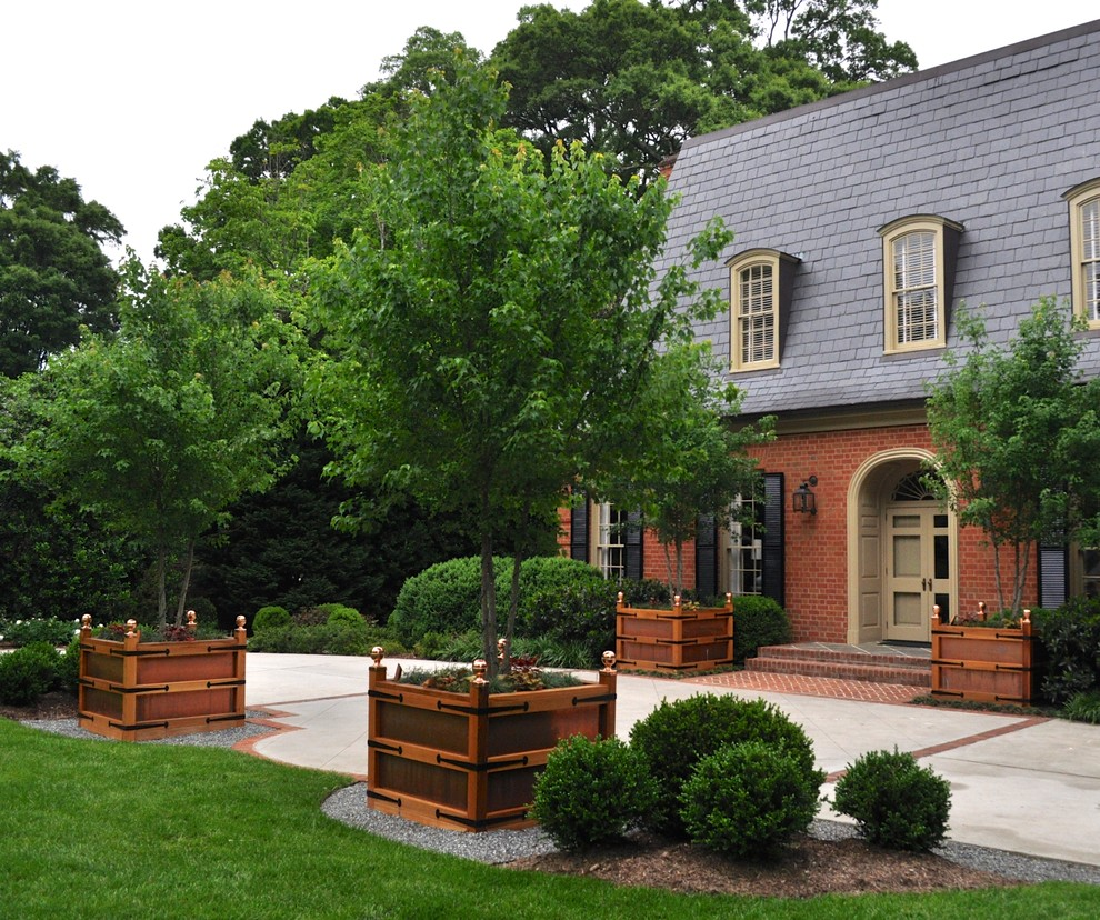 Large Ceramic Planters Exterior Traditional with Arched Entry Strap Hinges Bark Mulch Black Shutters Brick Brick Steps Dormers