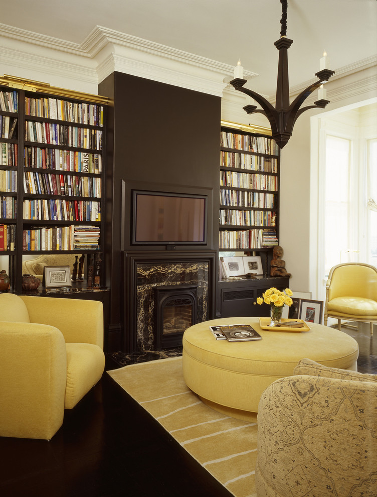 Large Round Ottoman Living Room Eclectic with Accent Wall Area Rug Arm Chair Bookshelf Mounted Light Bookshelves Brown Built in Bookshelves
