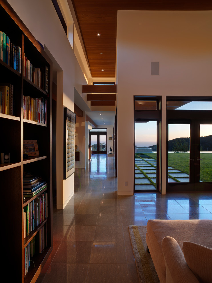 Lateral File Cabinet Home Office Contemporary with Bookcase Clerestory Windows Curved Ceiling Exposed Beams Limestone Tile Transom Windows Warm