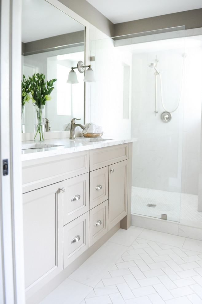 Laura Ashley Sheets Bathroom Transitional with Beige Walls Cup Pulls Double Vanity Herringbone Floor Pattern Open Shower Two