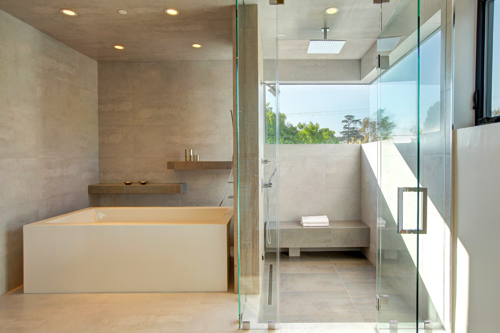 Lavatory Faucet Bathroom Contemporary with Concrete Floor Concrete Walls Cream Tub Curbless Shower Floating Shelves Frameless Glass
