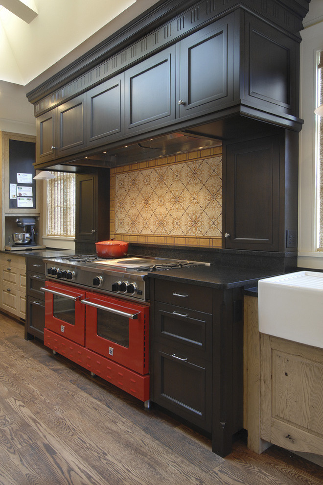 le creuset dutch oven Kitchen Traditional with kitchen hardware range hood red range two tone cabinets wood cabinets wood